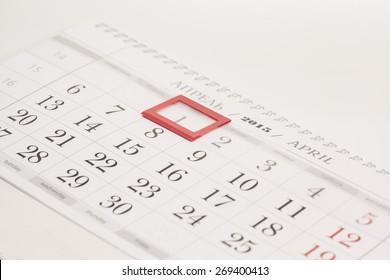 2015 year calendar. April calendar with red mark on framed date 1