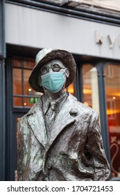 2015-11-23 Dublin Ireland-Statue of  James Joyce wearing a surgical mask. Concept of Coronavirus, COVID-19, isolation, protection and quarantine