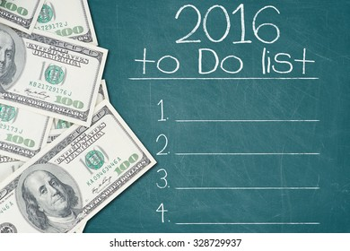 2016 TO DO LIST text written on a green chalkboard with a number of one hundred US dollar notes