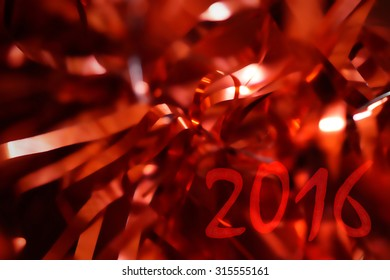 2016 inscription on a red background blurred