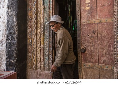 2016 Leh, Ladakh, India â?? July  26 2016  The old man was walking out the door from inside Hemis monastery complex in Ladakh, India, Asia.