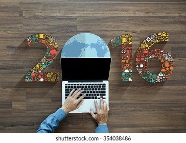 2016 new year business innovation technology set application icons, With businessman working on laptop computer PC, view from above