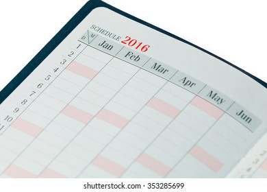 2016 Small calendar schedule notebook isolated on white background.