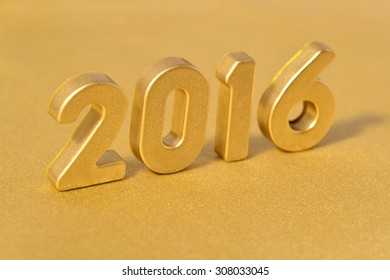 2016 year golden figures on a golden background