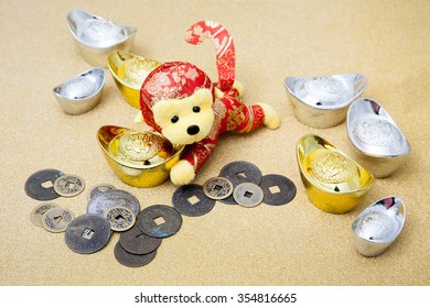 2016 is year of the monkey decorate with gold, silver ingot and ancient money for chinese new year