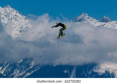 2017 04 Sochi, Russia, Festival NewStarCamp: snowboarder jumps from a high springboard