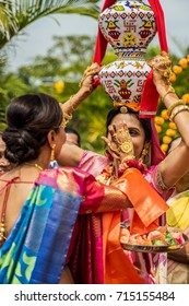 2017 Aug 14 Nairobi Kenya  Close maternal female relatives of bridegroom enjoying the traditional Indian Jaggo Ceremony, day before the marriage ceremony. An aunt is carrying a gagger on her head.