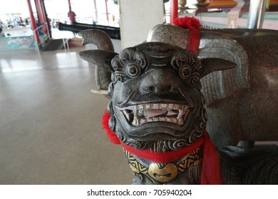2017, Bangkok, Thailand, Statue at Dragon descendants called kylin or qilin at the entrance to the Chinese shrine.