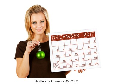 2017 Calendar: Holding December Christmas Ornament