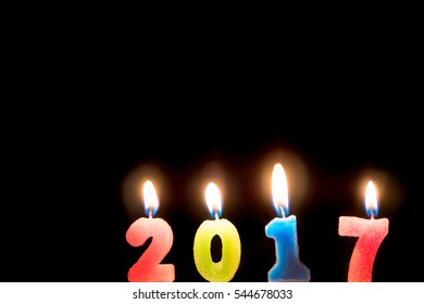 2017 candles numbers on black background. New Year Concept
