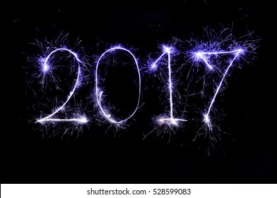 2017 from colorful sparkle on black background