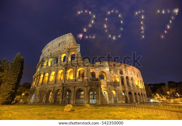2017 Firework New Year Concept Colosseum in Rome, Italy during sunset