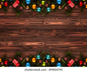 2017 happy new year seasonal background with real wood green pine colorful christmas baubles