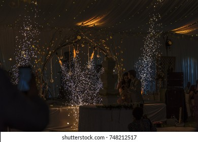subdued lighting. Dazzling Indoor Fireworks And Subdued Lighting Create A T