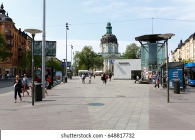 2017, may, Odenplan, the new metro/subway station is in place and people are enjoying the sunshine in the spring in Stockholm. Gustav Vasa church in the background.