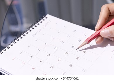 The 2017 new year calendar  on the glass table background with the red pencil