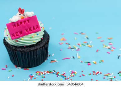 2017 new year chicken cupcake over blue background