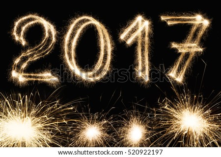 2017 new year font made from sparkler firework on black background two thousand seventeen numbers