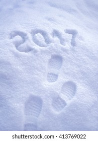 2017 New Year greeting card, 2017 new year, foot step prints in snow, happy new year 2017 concept