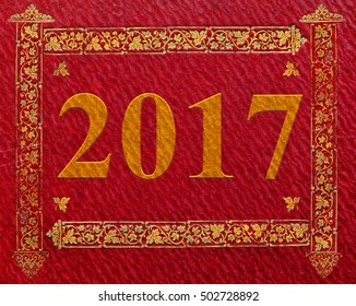 2017 New year on red textured background. Vintage book cover texture