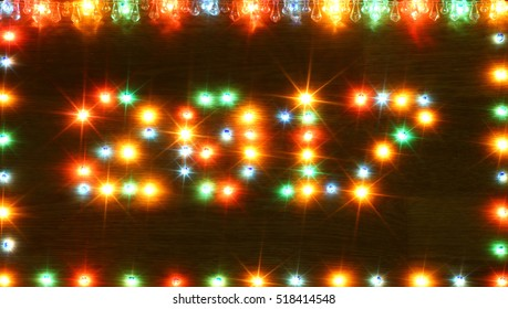 2017 new year on wooden desk table background. Number and frame border from colorful shiny lights lamp bulb. Conceptual for congratulation winter holidays greeting cards. Copyspace for text or logo.