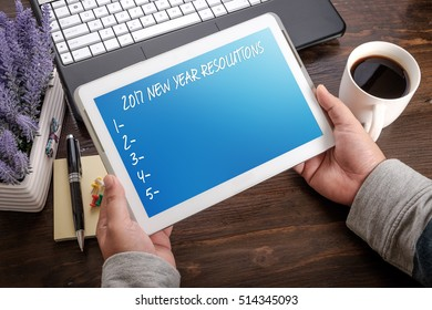 2017 NEW YEAR RESOLUTIONS on tablet pc. with blank checklist