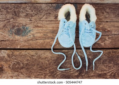 2017 new year written laces of children's shoes on old wooden background. Toned image. Top view.