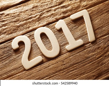 2017 on old retro vintage style wooden texture background