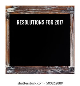 2017 resolutions on blank vintage chalkboard background, new year and business concept