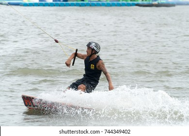 2017, September 16, Bangkok, Thailand: Man wake boarding on a lake with cable in Zanook Wake Park.