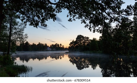 2017 summer, Night view over the lake. The old apartment in the background, a magnificent stone house by the lake in Strömsbruk, Nordanstig in the north of Sweden