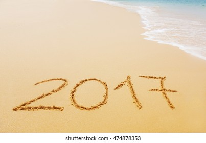 2017 written on sandy beach