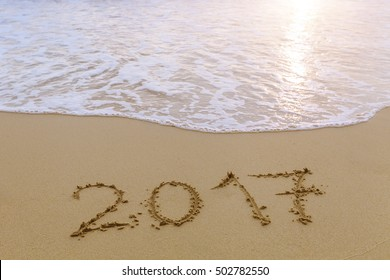 2017 written in the sand of a tropical paradise beach, concept about happy new year greetings