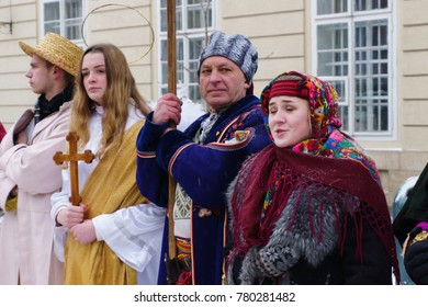2017-01-09 LVIV, UKRAINE - JANUARY 07, 2016 -  Participants traditional Christmas of Verteps Parade. People wearing carnival clothes singing song. Winter outdoor image.