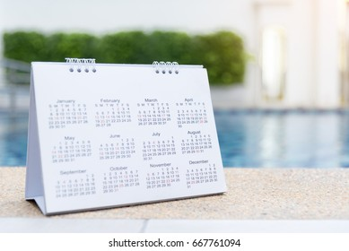 2018 Calendar Close up calendar setting timetable for organize schedule. Time management concept. Calendar timetable with timeline planning on swimming pool as a background.