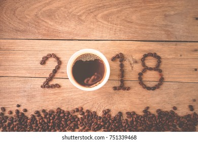2018 coffee beans on wooden table in vintage style for new year concept background