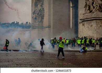 2018, December 1th - Paris, France: Protesters and police forces fighting at  during the Yellow Vests protest against Macron politic.