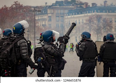 2018, December 1th - Paris, France: Police forces and Gendarmerie at Arc de Triomphe during the Yellow Vests protest against Macron politic.