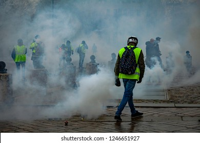 2018, December 1th - Paris, France:  Protesters at Arc de Triomphe between tear gas during the Yellow Vests protest against Macron politic.