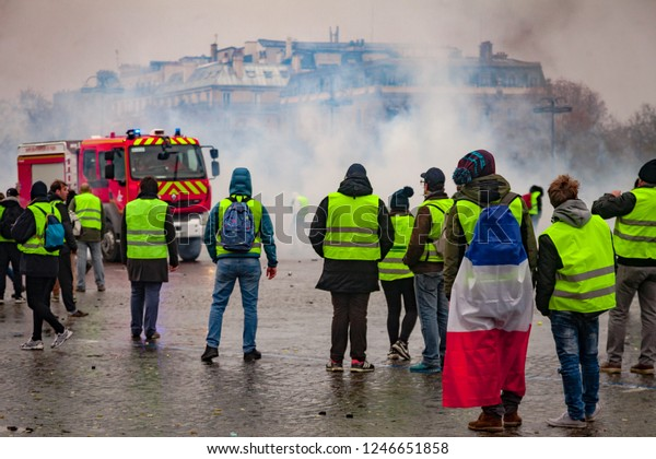 2018, December 1th - Paris, France: Protesters at  Arc de Triomphe during the Yellow Vests protest against Macron politic.