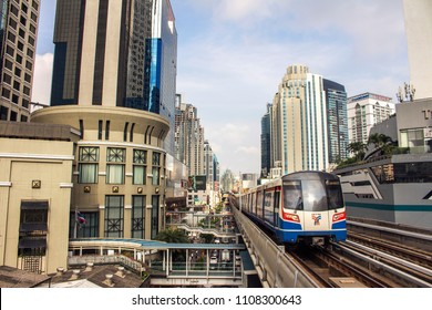 2018 Feb 26 Bankkok, Thailand - Bangkok metropolis skyline with BTS Skytrain or The Bangkok Mass Transit System approaching the station platform, this is the best way to avoid traffic in town