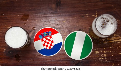 2018 Football Match Calendar with Beer Mats with Flags of Croatia and Nigeria.