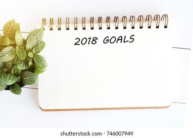 2018 goals on blank note paper background, new year aim to success in business background