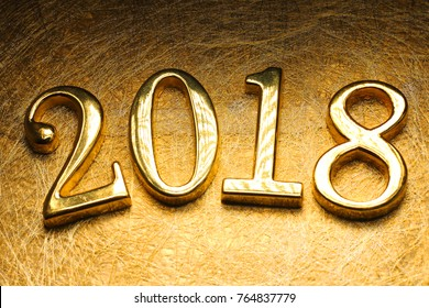 2018 gold numbers text and decoration. New year is the first day of the year in the Gregorian calendar.