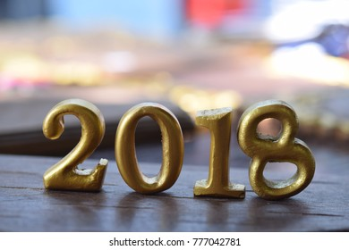 2018 Gold Text on wood. New year concept.
