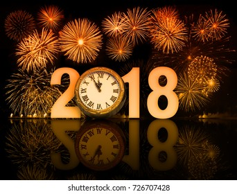 2018 happy new year fireworks with old clock face
