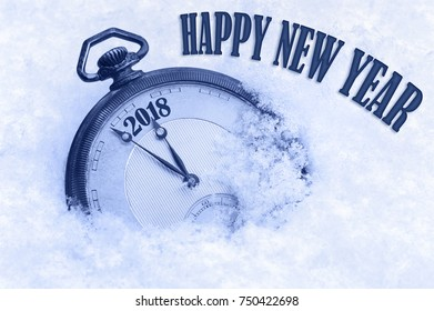 2018 Happy New Year, New Year 2018 greeting card, pocket watch in snow, English text