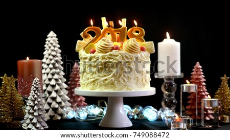 2018 happy new year showstopper cake decorated with white chocolate frosting cookies and candy centerpiece