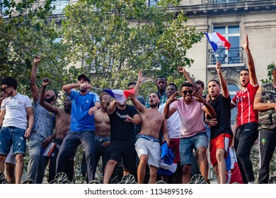 2018, July 15th - Paris, France: Street of Paris crowded of happy soccer supporters after the final match France Croatia.