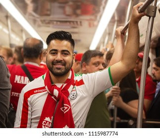 2018 June 15th, Saint Petersburg Russia, near St Petersburg stadium, FIFA world cup. Football fan of Iran in the subway. The man in Iranian uniform is wearing a Canadian scarf and smiling